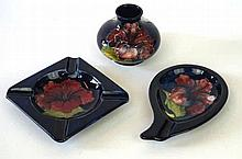 Three pieces of Moorcroft Pottery Decorated in the Hibiscus pattern, to inc