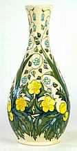 A modern Moorcroft vase  Of baluster form decorated with yellow and blue fl