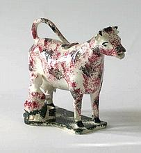 A Staffordshire type spongeware cow creamer Of typical form modelled in sta