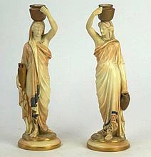 A pair of Royal Worcester Grecian style figures of water carriers dated 190