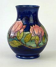 A Moorcroft Pottery vase of baluster form Decorated in a Magnolia pattern o