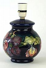 A Walter Moorcroft bulbous form lamp base Decorated in the Clematis pattern