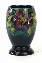 A Walter Moorcroft pedestal ovoid form vase Decorated in the Clematis patte