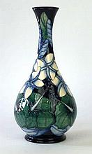 A modern Moorcroft pottery trial vase of baluster form Decorated with white