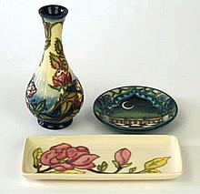 Three pieces of Moorcroft pottery  To include a baluster vase decorated in