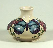 Modern Moorcroft pottery vase of squat form Decorated in Butterfly pattern