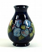 Walter Moorcroft pottery vase of baluster form Decorated in the Clematis pa