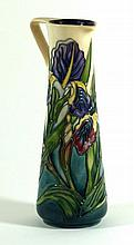 Modern Moorcroft pottery ewer of cylindrical form Decorated in the Iris pat