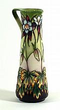 Modern Moorcroft pottery limited edition ewer of cylindrical form Decorated