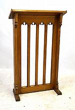 A Gothic Revival light oak lectern, early 20th Century The angled top secti