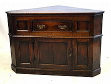 A George III free standing corner cupboard The triangular shaped top above