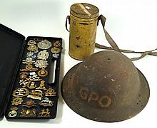 A WWII British GPO helmet  A tin cased WWII period gas mask, a case contain
