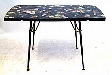 Post war drop-leaf kitchen table with formica top Decorated with still life
