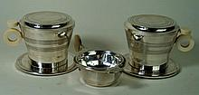 George VI Art Deco hallmarked silver tea strainer And matching bowl, the st