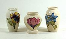 Walter Moorcroft three vases To include a magnolia vase, height 9.5cm, hibi