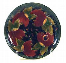 William Moorcroft circular plate Decorated in the pomegranate pattern with