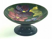 Walter Moorcroft pedestal comport  Decorated in the clematis pattern on a g
