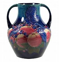 Modern Moorcroft pottery twin handled bulbous form vase Decorated in the Bl