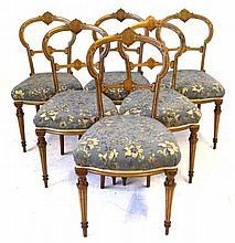 A set of six Victorian inlaid walnut balloon back dining chairs Each elegan