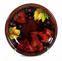 Walter Moorcroft pottery flambé circular plate  Decorated in the leaf and