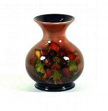 Walter Moorcroft pottery Flambé vase of bulbous form with flared neck Deco
