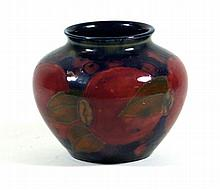 William Moorcroft pottery vase of bulbous form  Decorated in the Pomegranat