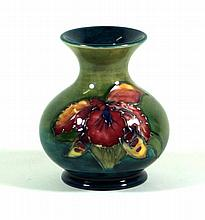 Walter Moorcroft pottery vase of bulbous form with flared neck Decorated in