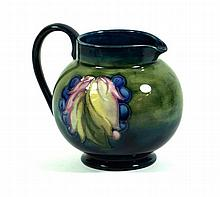 Walter Moorcroft pottery jug of bulbous form Decorated in the Leaf and Berr