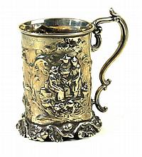 A Victorian silver tankard Of cylindrical form, embossed with leaf and frui