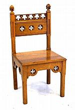 A carved light oak Gothic Revival hall chair by Hayes & Finch of Liverpool,