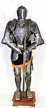 A complete suit of 16th Century style armour, late 20th Century The fully a