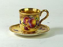 Royal Worcester hand-painted coffee can and saucer Decorated with fruit, by