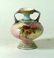 Royal Worcester twin handled hand-highlighted vase Decorated with flower he