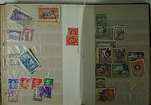A small collection of both mint and used postage stamps Comprising two albu