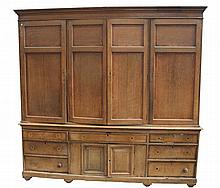 A George III oak and mahogany crossbanded housekeepers cupboard, with a cav