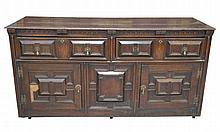 A 19th Century oak Jacobean style sideboard The rectangular moulded plank t