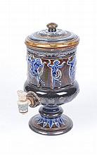 A Doulton Lambeth water filter, dated 1882 The spreading circular base, ris