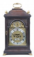 A mid 19th Century ebonised and brass moulded table clock The elegant eboni