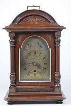 A 19th Century mahogany cased chiming mantel clock The arched reeded case w