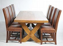 A Contemporary golden oak refectory table and a set of eight conforming hig
