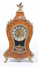 A 20th Century Italian marquetry effect balloon mantel clock Of typical rou