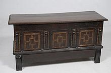 A 17th Century and later oak and marquetry blanket chest The rectangular two plank top above three panels each inlaid with holly and ebony in a geometric pattern flanked by inlaid panels with applied tapering baluster above a frieze drawer, shaped