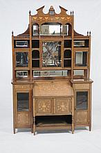 A Choice Edwardian inlaid rosewood and mahogany bureau cabinet circa 1900 In the manner of of Edwards and Roberts, with an architectural pediment centred with a satinwood flower head above a fretwork mirror panel, turned vase shaped finials above a