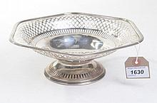 A Edward VII silver pierced pedestal dish Of hexagonal form, raised on a pierced spreading circular base, extending to a deep well with reticulated basket type rim, Ellis Jacob Greenburg, Birmingham, 1908, 13.5oz, 9cm high.