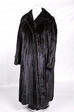 A fine quality chocolate mink coat, circa 1970's Full length of swing form, with flared sleeves with button detailing, decorative embroidered lining, chest width approx 41in.(illustrated)