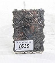 An Edward VII silver card case Of scalloped rectangular form, with central diamond shaped reserve and cartouche with monogram F. L., set before heavily engraved floral detail and studded design, Joseph Gloster, Birmingham, 1907, 2.4oz, 9cm long.