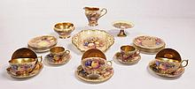 An Aynsley still life fruit pattern service Each piece decorated with still life, grapes, peaches, berries and leaves comprising, six cups each with heavily gilt interiors and handles, six saucers, six 16cm diameter side plates, two coffee cups and