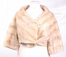 A Kendal Milne of Manchester cream mink cropped jacket, circa 1960's Collarless with crossover design and twin button fastening to front, cropped arms, lined with decorative embroidered detail, chest approx 40in, labelled.
