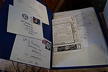 A folder containing various news articles and auto