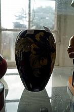 A Moorcroft vase of ovoid form, decorated in the H